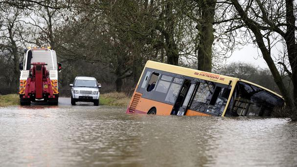 A bus swept off the road by floodwater between Newton-on-Ouse and Tollerton, north of York
