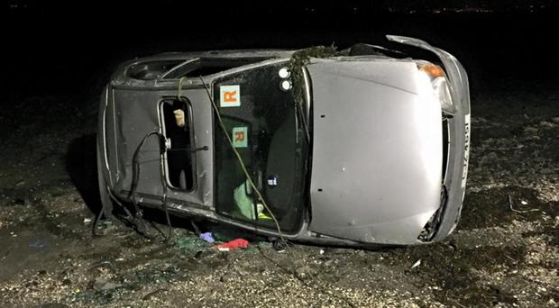 The overturned car at Strangford Lough last night