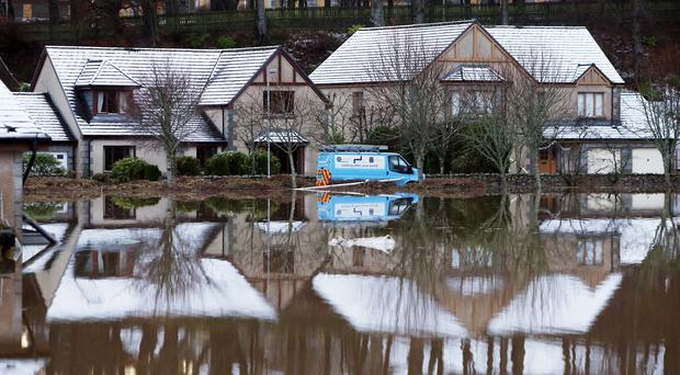 Flooded houses at Port Elphinstone, near Aberdeen, after the River Don burst its banks