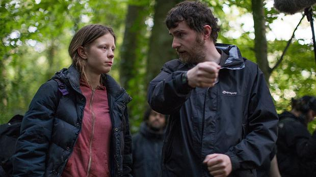 Stephen Fingleton on the set of The Survivalist with actress Mia Goth (NI Screen/PA)