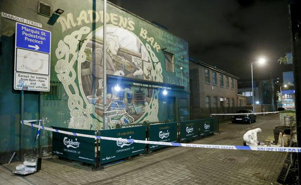 A forensics officer outside Maddens last night