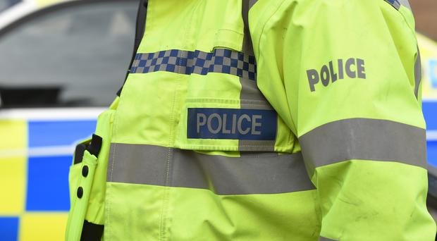 Four police officers were injured when a suspected stolen car hit their vehicles in west Belfast