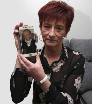 Jennifer Hoy with a picture of her father David Crothers, aged 87