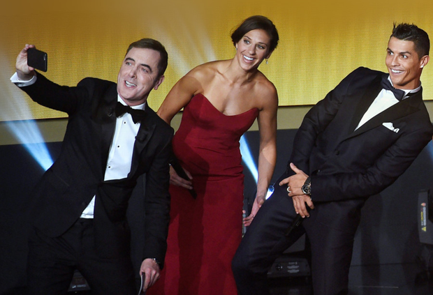 James Nesbitt grabs a selfie with USA midfielder Carli Lloyd and Cristiano Ronaldo at the ceremony