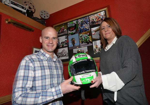 Ulster racing star Ryan Farquhar with Richard Britton's widow Maria at the launch of the documentary in tribute to the late rider