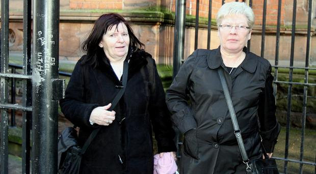 Pearse Jordan's mother Teresa, left, leaves the Coroners Court in Belfast with Marie Cush, a Sinn Fein councillor