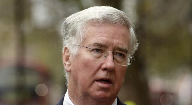 Defence Secretary Michael Fallon has been criticised over the sale of the golf courses