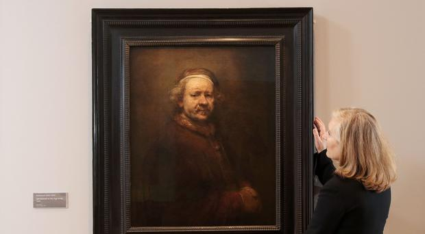 Curator of fine art at National Museums Northern Ireland, Anne Stewart, adjusts Self Portrait At The Age Of 63 by Rembrandt at the Ulster Museum (Press Eye/PA)