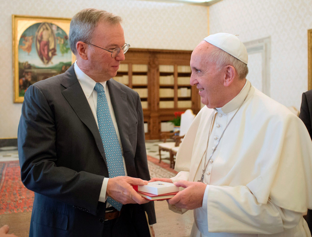 Pope Francis receives gifts from executive chairman of Google Eric Schmidt during a private audience in the Vatican yesterday