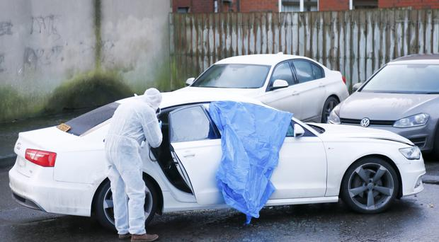 An Audi is towed away after its driver was cornered in east Belfast yesterday