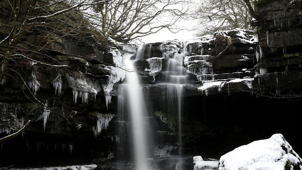 A waterfall surrounded by icicles at Gibsons cave in Bowlees Visitor Centre, County Durham