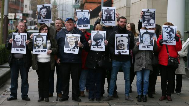 Campaigners stand outside Laganside Courts in Belfast
