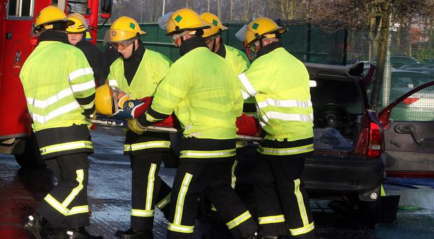 Health minister Simon Hamilton was urged to act by Stormont Assembly members before fire service cuts risk lives