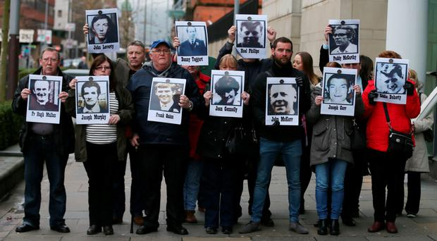 Campaigners whose family members were shot dead by soldiers in the 1971 Ballymurphy massacre stand outside Laganside Courts