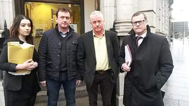 (left to right) Rosie Kinear from KRW Law, Damian Brown, Paul O'Connor from the Pat Finucane Centre, and solicitor Kevin Winters outside Mays Chambers Coroner's Court in Belfast following a preliminary hearing for an inquest into the death of GAA official Sean Brown