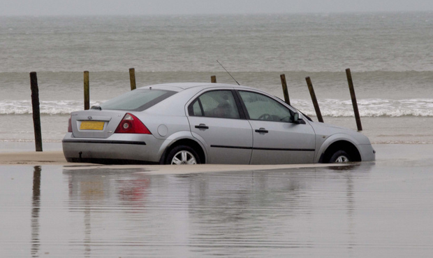 The silver Mondeo stuck on Portstewart Strand yesterday