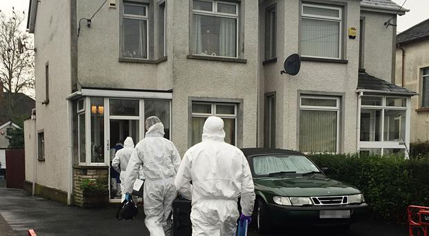 Forensic officers at 162 Station Road where retired plumber Eddie Girvan, 67 was found murdered
