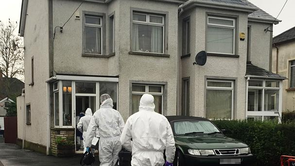 Forensic officers at the scene in Station Road where Eddie Girvan was found murdered