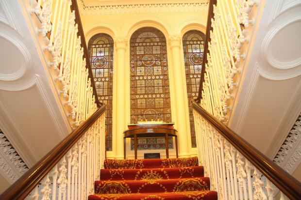 The original staircase and stained glass window at IFA headquarters on Belfast's Windsor Avenue