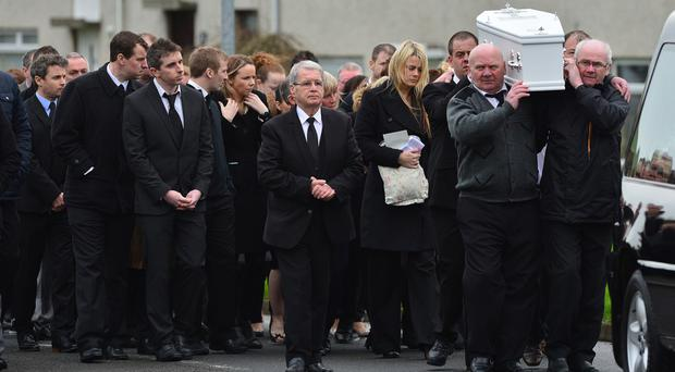 Family and friends gather for the funeral of six-year-old Joshua Kelly at St Patrick's Church in Portaferry