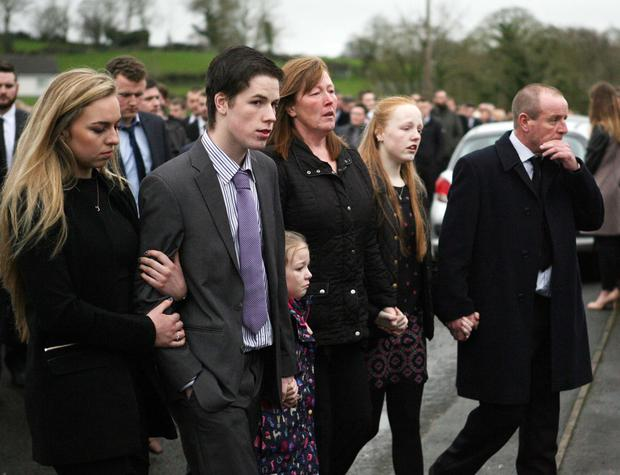 The family of Andrew Gass — brother Matthew, sisters Emma and Louise and parents Heather and Hyland — at his funeral