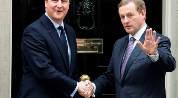 Prime Minister David Cameron greets his Irish counterpart Enda Kenny outside 10 Downing Street