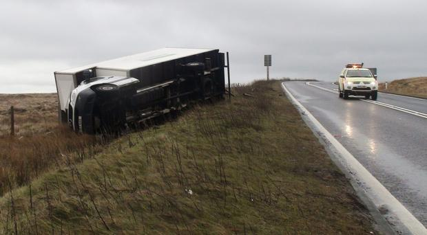A lorry blown over by high winds on the A628 Woodhead Pass in South Yorkshire