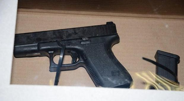 A Glock Pistol, one of of two firearms recovered from a car at the cemetery (PSNI / PA Wire)