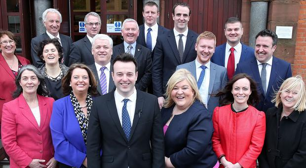 SDLP leader Colm Eastwood (front centre) as he unveils his new team of party spokesmen and women to shadow the new Executive departments at Stormont (PA/SDLP)