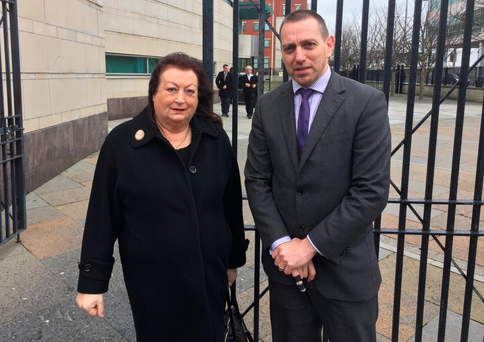 Patrick McVeigh's daughter Patricia and her solicitor Padraig O Muirigh outside Belfast's Laganside Courts yesterday