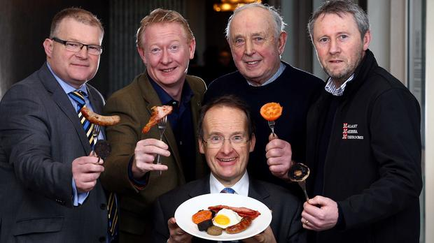 Howard Hastings (front), managing director of Belfast's Europa Hotel's owner Hastings Hotels, being joined by local food producers to celebrate Ulster FryDay (PA/Hastings Hotels)