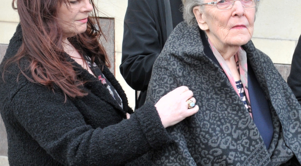 Rosemary Campbell, widow of murdered Catholic RUC officer Sergeant Joe Campbell, is comforted as she leaves Belfast Coroners Court yesterday