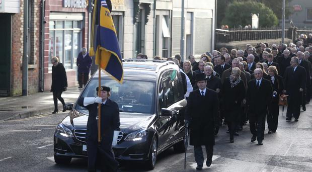 The funeral cortege makes its way from St Patrick's Church in Ballymoney
