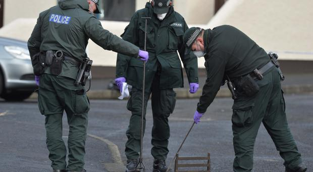 Police at the scene following the death of 48-year-old Anthony McErlain in Ballycastle