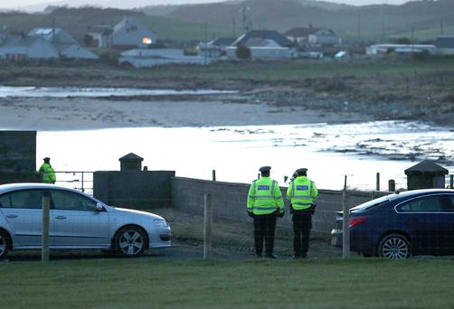 Police at Tyrella beach, Co Down where the body of a woman was found