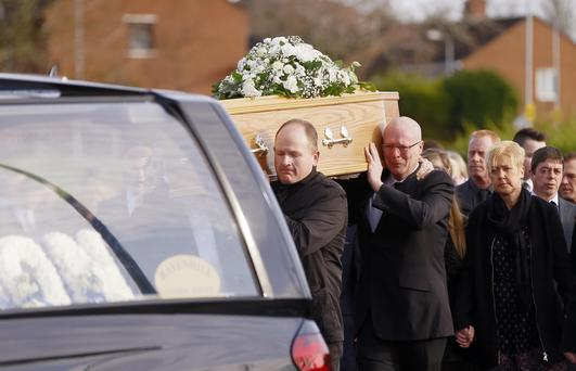 Family and friends gather at the funeral of Adam McCormack at Milltown Baptist Church in Belfast yesterday