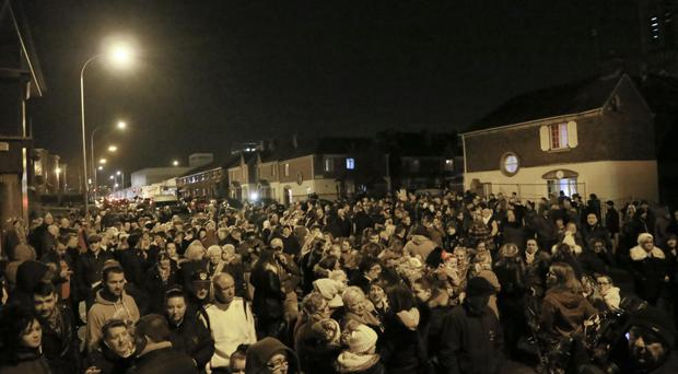 Members of the public attend a rally held in Divis Street last night following a recent attack on Maureen Shepherd