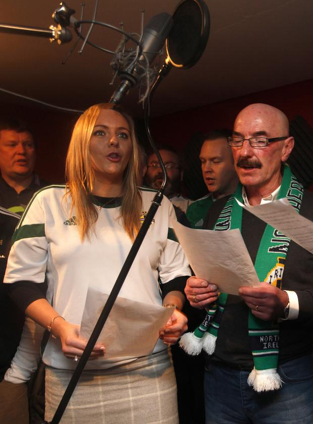 UTV's Ruth Gorman and Liam Beckett, with local fans, recording the new Northern Ireland football song
