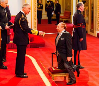 Sir Ivan Morrison is made a Knight Bachelor of the British Empire by the Prince of Wales during an Investiture ceremony at Buckingham Palace yesterday