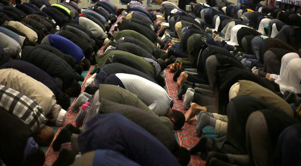 Prayers during an open day at the East London Mosque in Whitechapel, London
