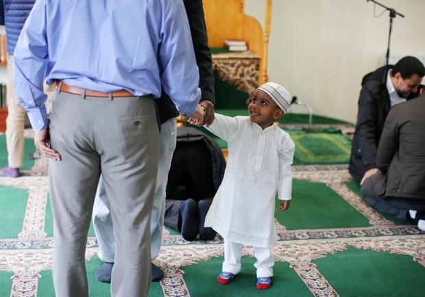 Young Mohammed looks on after prayers take place during an open day at Belfast Islamic Centre in Wellington Park, Belfast. More than 90 mosques across the UK opened their doors to the public in an effort to 'explain their faith beyond the hostile headlines'