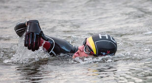 Greg James starts the first of his five triathlons, in Belfast (Comic Relief/PA)