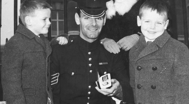 Ken Lewis of the Irish Guards with his wife Kate and two eldest sons after he received the Military Medal