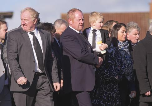 Noel Watt and son Daryl lead the cortege at the funeral of Lisa Watt yesterday