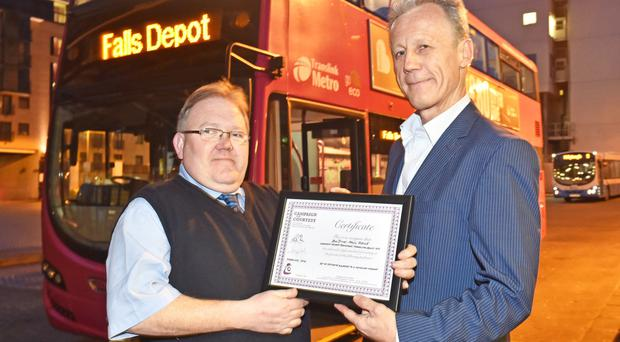 Paul Doyle receives his award from PR Smith of the National Campaign for Courtesy