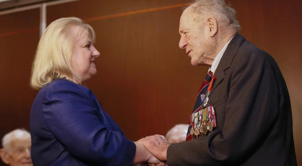 The Honorary Consul for France presents Frank with his medal