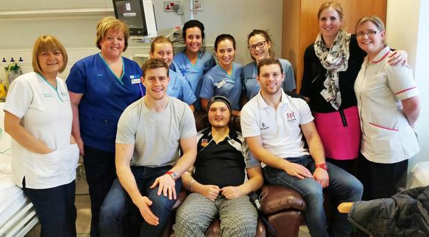 Kieran Bowes with Ulster Rugby stars Andrew Trimble and Darren Cave and the hospital staff who looked after him