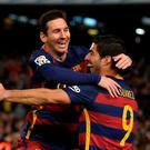 Barcelona stars Lionel Messi and Luis Suarez celebrate