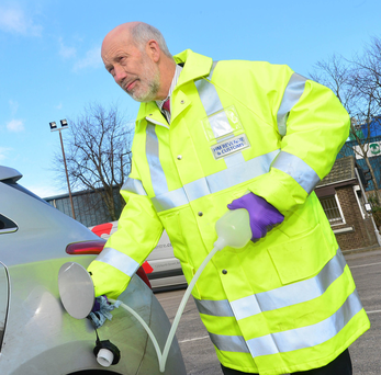 Justice Minister David Ford tries out the new roadside fuel testing equipment