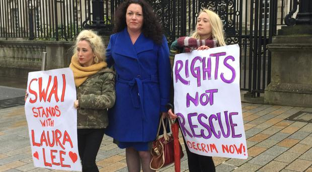 Sex worker Laura Lee, centre, with Kate McGrew, of the Sex Workers Alliance, left, and Dearbhla Ryan, a community worker with the group